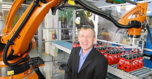 Henrik Christensen with KUKA industrial robot